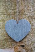 Wood texture love heart on tree trunk — Stock Photo