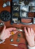 Woman's making  assembling craft jewellery — Stock Photo