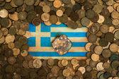 Burnt Greek flag euro coins background — Stock Photo