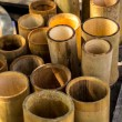 Bamboo cylindrical, yellow, dry, green, bamboo pile. — Stock Photo #64740555