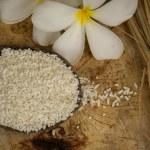 Wooden Spoon rice, wood floors, brown, jasmine rice, surface. — Stock Photo #71324729