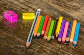 Sort crayons flooring surfaces, bright colors, red, yellow, blac — Stock Photo