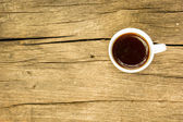 Coffee cup on wooden table. View from top — Stock Photo
