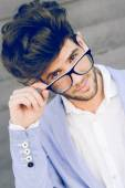 Cheerful trendy guy with black eyeglasses on  — Stock Photo