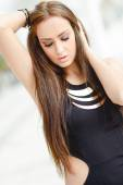 Young woman, wearing casual dress with long hair — Stock Photo