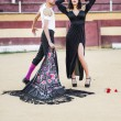 Couple, models of fashion, in a bullring — Stock Photo #61960615