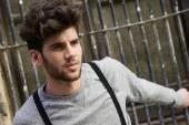 Man wearing suspenders in urban background — Stock Photo