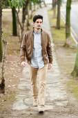 Attractive young handsome man, model of fashion in urban backgro — Stock Photo