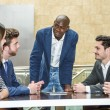 Group of multiethnic busy people working in an office — Stock Photo #71348521
