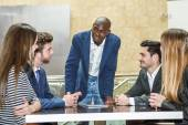 Group of multiethnic busy people working in an office — Stock Photo