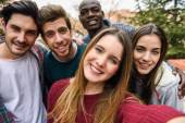 Multiracial group of friends taking selfie — Stock Photo