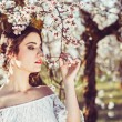 Portrait of young woman in the flowered garden in the spring tim — Stock Photo #72971179
