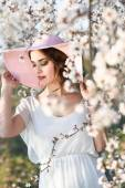 Portrait of young woman in the flowered garden in the spring tim — Stock Photo
