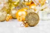 Red christmas ornaments with golden christmas bauble  — Stock Photo