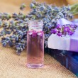 Natural handmade lavender Liquid soap and solid soap with fresh lavender flowers, on sackcloth — Stock Photo #52529253