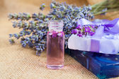 Natural handmade lavender Liquid soap and solid soap with fresh lavender flowers, on sackcloth — Stock Photo