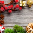 Christmas decoration on wood background, with free space for you — Stock Photo #54371197