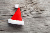 Single Santa Claus red hat on wooden background — Stock Photo