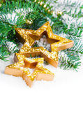 Golden Christmas stars with pine branch and snow, with free spac — Stock Photo