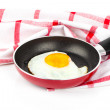 Fried egg in a frying pan, over white background — Stock Photo #55267143