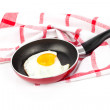 Fried egg in a frying pan, over white background — Stock Photo #55267323