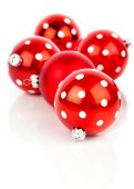 Red polka dot Christmas bauble, isolated over white — Stock fotografie