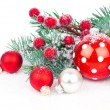Christmas balls and fir branches with decorations isolated over — Stock Photo #55270713