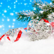 Christmas decoration over snow, blue background — Stock Photo #57088037