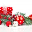 Christmas balls and fir branches with decorations isolated over  — Stock Photo #57092461