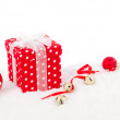 Christmas red gift with branch firtree, isolated over white — Stock Photo #57093165