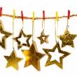 Golden Christmas stars, isolated over white background — Stock Photo #57093617