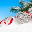 Christmas decoration over snow, blue background — Stock Photo #57647507