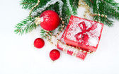 Christmas gift and balls on fir branches ,over white — Stock Photo
