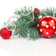 Christmas balls and fir branches with decorations isolated over — Stock Photo #58614155