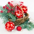 Christmas balls and fir branches with decorations isolated over — Stock Photo #58614329