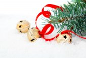 Christmas jingle bell with red ribbon, with snow — Stock Photo