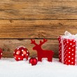 Red gift for christmas on a wooden background with sno — Stock Photo #60855237