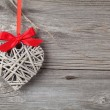 Heart shaped decoration made of wood, over wooden background — Stock Photo #61495177