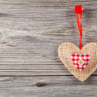 Heart shaped decoration made of wood, over wooden background — Stock Photo #61496015