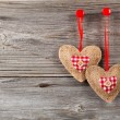 Heart shaped decoration made of wood, over wooden background — Stock Photo #61496727