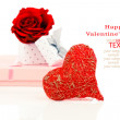 Red heart shape symbol made from thread with gift on white backg — Stock Photo #62087867