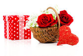Red heart shape symbol made from thread with basket with roses o — Stock Photo