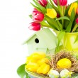 Easter eggs with tulips flowers and birdhouse, on a white backgr — Stock Photo #62615369