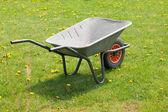 Garden-wheelbarrow on green grass — Stock Photo