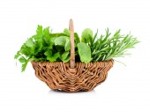 Sage, parsley and rosemary in wicker basket, on a white backgrou — Stock Photo