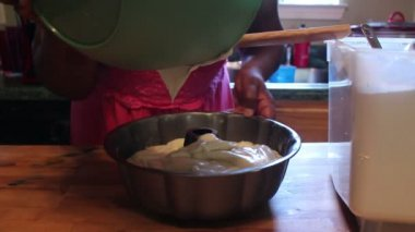 Pouring Cake Batter into Pan — Stock Video