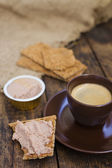 Cup of coffee and toast with paste — Stock Photo