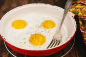 Fried eggs in a frying pan — Stock Photo