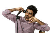 Young man struggling with a crazy telephone — Stockfoto