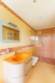 Beautiful orange bathroom — Stock Photo